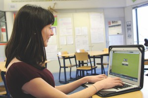 Eighth grader Lilly Ferragamo enters a game pin into the Kahoot website. Since the game pins are unique to each game, it is almost certain that only your class will be in the game, with no outside interference (photo by Anisa Cooper).
