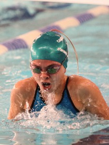Eighth grader Anna Podurgiel, comes up for a breath in her 200 meter breast stroke race. This competition was at Middlesex county last fall (photo courtesy of Anna Podurgiel ).