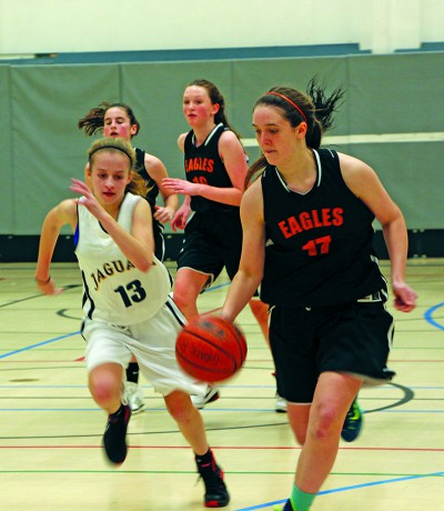 Lindsay Harris drives the ball down the court as she intercepted a pass from an opponent. This was during a home game against ACS Egham on December 15, and the Eagles won 42-23.(Photo by Cloe Tchelikidi)
