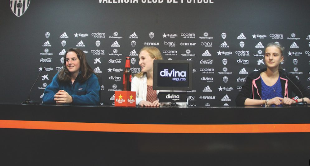 At the Valencia Club Football Stadium, students were given a tour of the stadium as well as tours of the changing rooms and press areas. Eighth graders Anna Kopfler, Katie Stone, and Natalie Vann sit at the press table (photo by Bella Worrell).