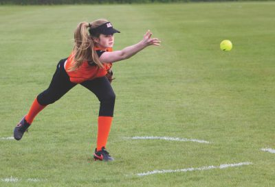 Eighth-grader Ava Crawford delivers a pitch on May 17. This was during a game against ACS Cobham where the team won 8-2 (photo by Cloe Tchelikidi).