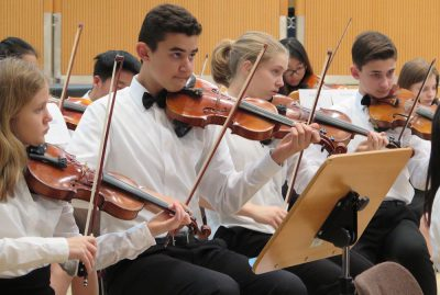 Former ASL eighth grader Jay Ramaswamy plays alongside eighth graders Sofi Janssen and Gabe Hajjar in Salzburg for the AMIS music festival (photo from http://amis-online.org).